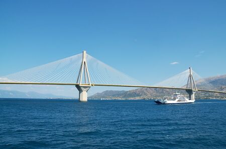 Rio -Antirio, cable-stayed bridge and ferry boat Фото со стока