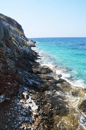 Coastal cliffs and deep blue waters