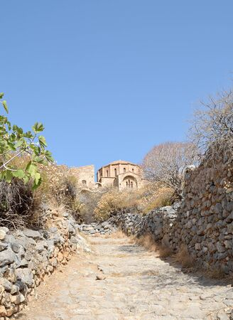 The uphill pathway leads to church of Agia Sofia at Monemvasia, Lakonia, Greece Фото со стока