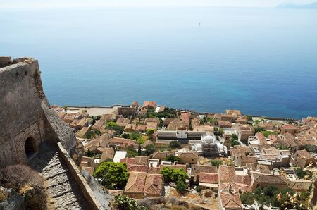 Central gate of upper town and view of Myrtoon sea and downtown of Monemvasia , Greece