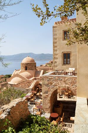 Old church and coffee bar in the fortress town of Monemvasia