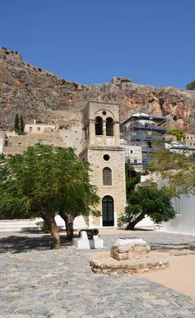The main square of Monemvasia with the bell tower of Jesus Elkomenos and an old cannon
