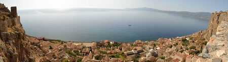 Panoramic view of  Monemvasia's  stone houses and Myrtoon sea from hillside