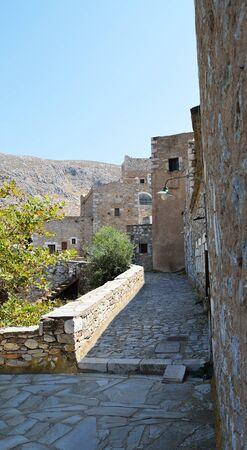 Narrow paved alley town Vathia, Laconia, Greece