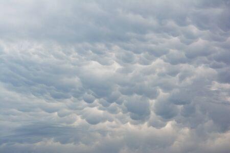 Grey mammatus clouds cover the sky