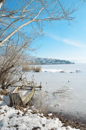 Winter scenery in lake Orestiada and town Kastoria as background