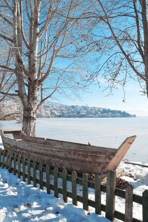 Beautiful winter snow scene in lake Orestiada in Kastoria , Greece