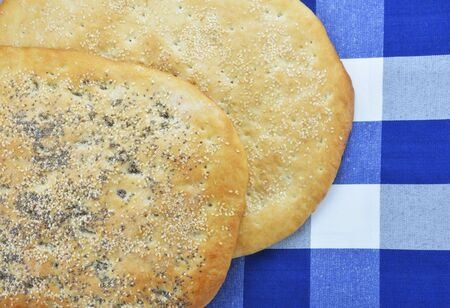 Greek sesame flatbreads on checked tablecloth