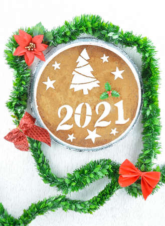 2021 new years cake decorative with green garland and red bows