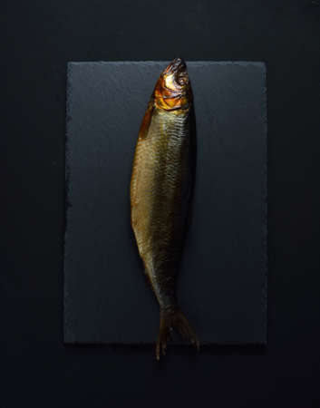 Smoked herring on black background Zdjęcie Seryjne