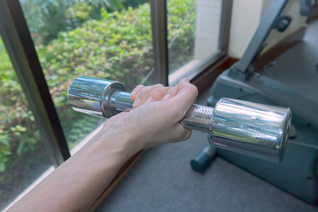 Woman s hand hold dumbbell
