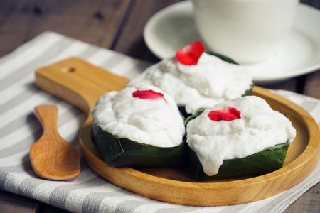 Thai pudding with coconut topping on wood plate Stok Fotoğraf