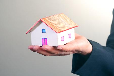 House model on businessman s hand