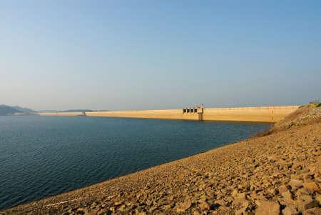 Sunrise at Khun Dan Prakarnchon Dam in Thailand photo