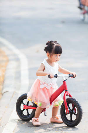 Happy Girl ride the Bicycle Stock Photo