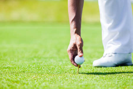 Professional Golf Player teach how to Teed Up Golf Ball Stock Photo