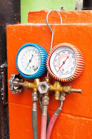 Pressure Air Gauge Hang on Orange Wall prepare to work