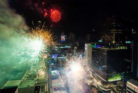Firework New Years Celebration BANGKOK, THAILAND - DECEMBER 31, 2017: Colorful Firework Display Celebrate Start to 2018 over Central World a Cityscape of the center area around Ratchadamri road in Bangkok, Thailand