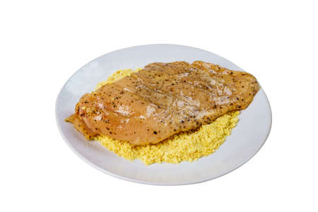 Close Up Raw Chicken Breast Fillets Cooking on Crispy Breads after Dip into Yawn Eggs with White Isolated Background.