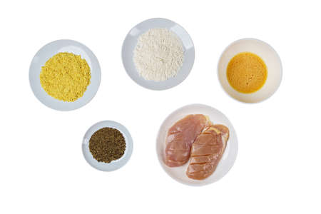 Group of Healthy Food Raw Chicken Breast Fillets for Cooking with Flour, Eggs, Bread Crunchy, Herbs and Peppers on Isoltaed Background. Zdjęcie Seryjne