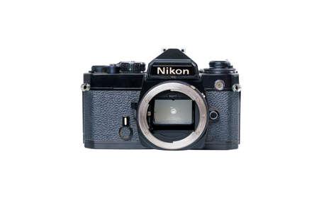 BANGKOK, THAILAND - JUNE 5, 2020 Retro Vintage Classic Nikon FE Film Camera without Lens on white background in Bangkok, Thailand on JUNE 5, 2020
