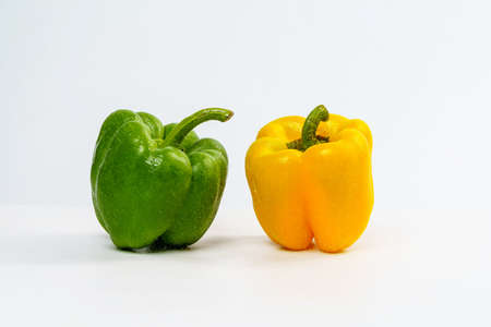Yellow and Green Bell Pepper Wet from Spray Water Drop on Isolated White Background.