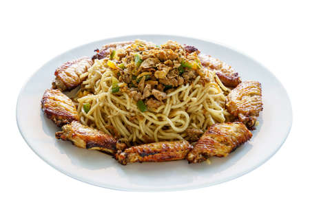 Stir Noodles with Pork, Fried Onion, Bell Pepper and Chicken Middle Wings on White Dish Isolated Background. Fusion Food and Group Concept Zdjęcie Seryjne