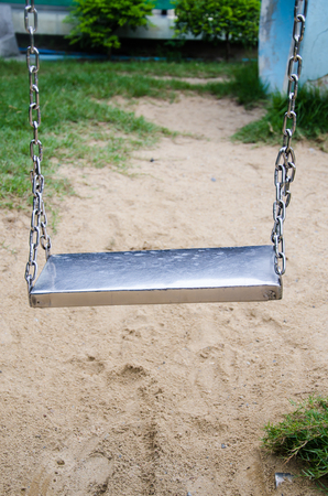 stainless swing in park Stock Photo - 22363657