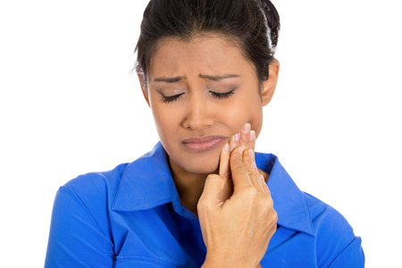 tooth ache: Closeup portrait of young woman with sensitive tooth ache crown problem about to cry from pain touching outside mouth with hand Stock Photo