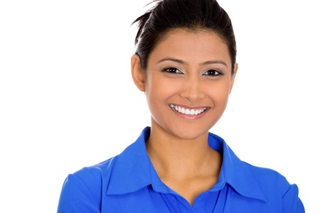 Closeup head shot portrait of confident smiling happy pretty young woman wearing blue shirt Stock Photo