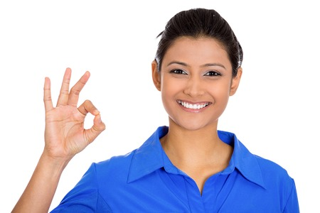 Closeup portrait of young happy, smiling excited beautiful natural woman giving OK sign with fingers