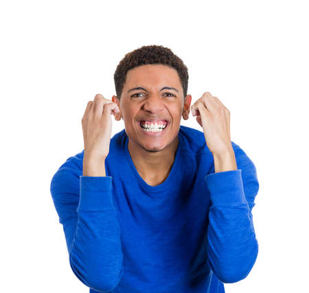 enrolled: Closeup portrait of handsome happy, screaming young student man, winning, arms, fists pumped celebrating success, isolated on white background  Positive human emotions, facial expressions, feelings