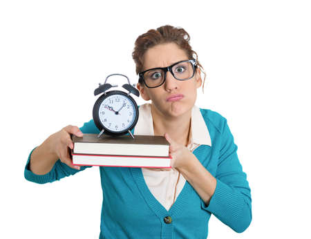 project deadline: Closeup portrait of nerdy young woman with glasses carrying tons of books, stressed from project deadline, isolated on white background. Negative emotion facial expression feelings, body language