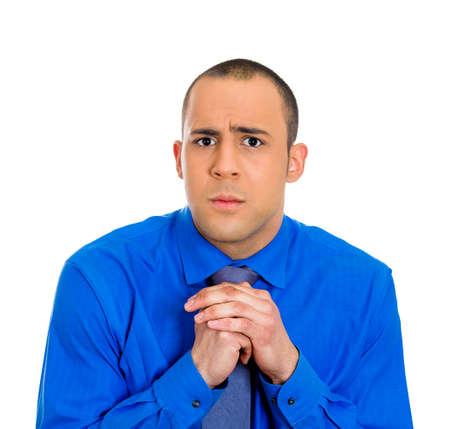 Closeup portrait of a young  man with shirt, very timid, shy and anxious, playing with hands nervously, isolated on a white background. Mental health, emotion facial expression feeling. Body language