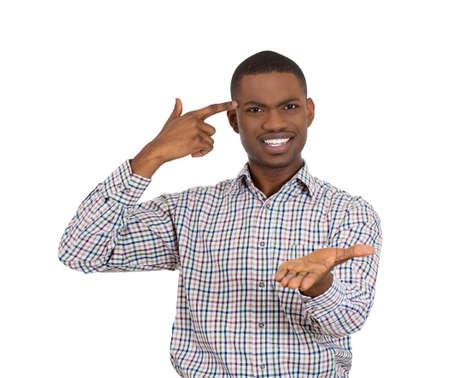 garcon africain: Gros plan portrait de grossier difficile jeune homme en colère, faisant des gestes avec son doigt sur sa tempe, êtes-vous fou? Isolé sur fond blanc. Émotions humaines négatives, l'expression du visage, des sentiments