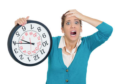 pressured: Closeup portrait of  business woman, student, worker employee holding clock, looking anxious at you, pressured by lack of time, running out of time isolated on white background. Negative human emotion