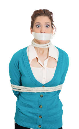 depravity: Closeup portrait of uncomfortable concerned scared woman with mouth taped shut and tied with rope, kidnapped, isolated on white background.  Social injustice, human depravity, misdemeanor, felony.