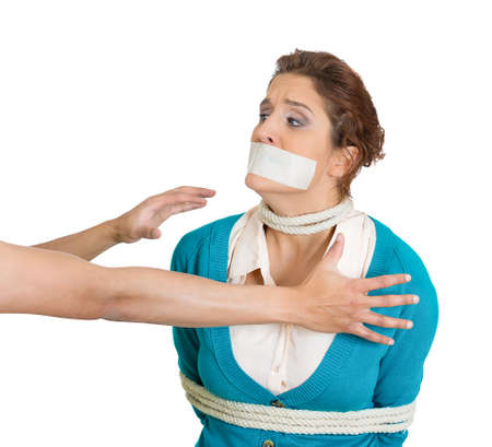 depravity: Closeup portrait of scared woman with mouth taped and tied with rope, kidnapped, arm reaching out grabbing her, isolated on white background.  Social injustice, human depravity, misdemeanor, felony.
