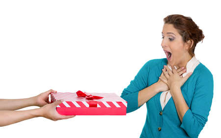 receptive: Closeup portrait of happy dumbfounded flabbergasted woman receiving red gift box, very pleased with what she received, isolated on white background. Positive emotion facial expression feeling attitude Stock Photo