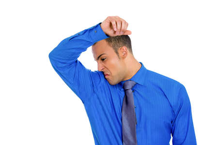 intolerable: Closeup portrait of young man, smelling, sniffing his armpit, something stinks, very bad, foul odor situation, isolated on white background  Negative human emotions, facial expressions, feelings Stock Photo
