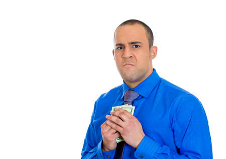 miser: Closeup portrait of greedy man corporate business employee, worker, student holding dollar banknotes tightly, isolated on white background  Negative human emotion facial expression feeling