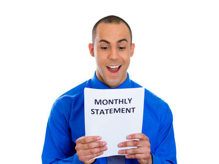 refinance: Closeup portrait of happy excited young man looking at monthly statement glad to pay off bills, isolated on white background  Positive emotion facial expression feelings  Financial success, good news