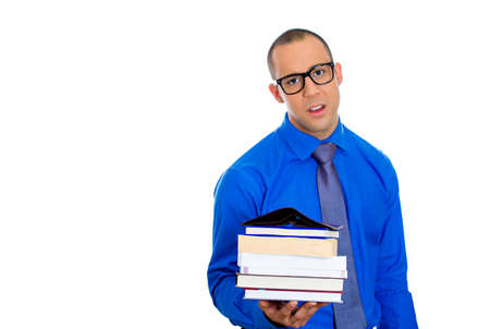 lack of confidence: Closeup of a young nerdy man, wearing big black glasses, holding books, anxious in anticipation of finals, exam test, isolated on white background  Negative facial expressions, feelings, emotions Stock Photo