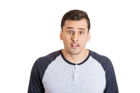 electrifying: Closeup portrait of shocked stunned surprised handsome young man, eyes and mouth wide open jaw drop, isolated on white background. Negative emotion facial expression feeling perception, body language