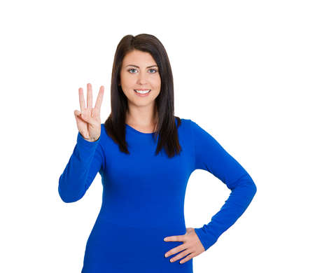 triad: Closeup portrait of young pretty smiling woman giving three fingers sign, gesture with hands, isolated on white background. Positive human emotions, facial expressions, feeling, symbols, body language