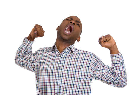 unskilled worker: Closeup portrait of handsome tired fatigued man stretching arms, back, shoulders , yawning, isolated on white background. Negative emotion facial expression feeling