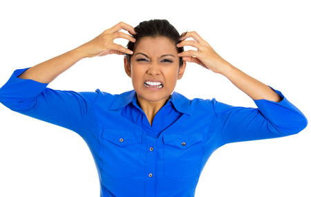 Closeup portrait of mad stressed young woman pulling hair upset about to have nervous breakdown, isolated on white background. Negative emotions, facial expressions, feelings, body language, attitude Stock Photo - 25792403