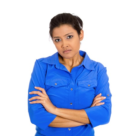 Closeup portrait of displeased pissed off angry grumpy young woman with bad attitude, arms crossed looking at you, isolated on white background . Negative human emotion facial expression feeling Stock Photo