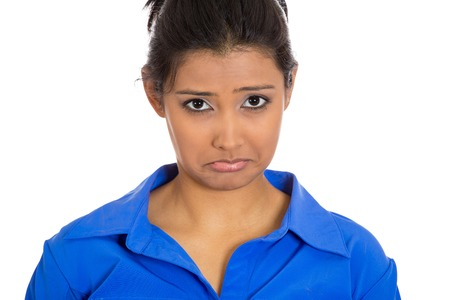 Closeup portrait of dull upset sad bothered young woman making puppy dog face, really depressed about something, isolated on white background. Negative emotion facial expression feeling, body language photo
