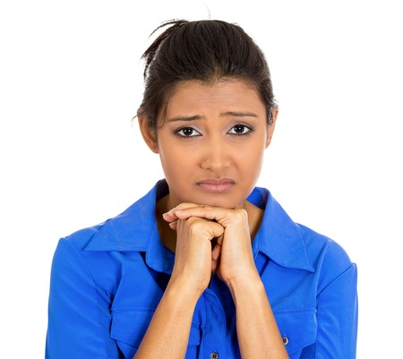 unhappy worker: Closeup portrait of dull upset sad bothered young woman resting face on hand, really depressed about something, isolated on white background. Negative emotion facial expression feelings, body language